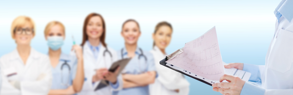 female doctor holding clipboard with cardiogram
